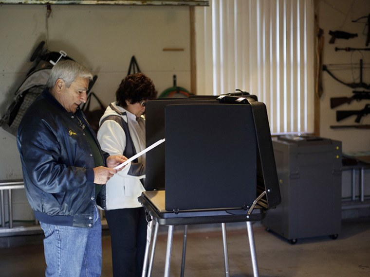 Gene Dovin, left, and his wife Bea Dovin, both of Forest City casts their votes at a polling place inside a residential garage, Tuesday, Nov. 6, 2012, in Forest City, Pa. (Photo by Matt Slocum/AP)