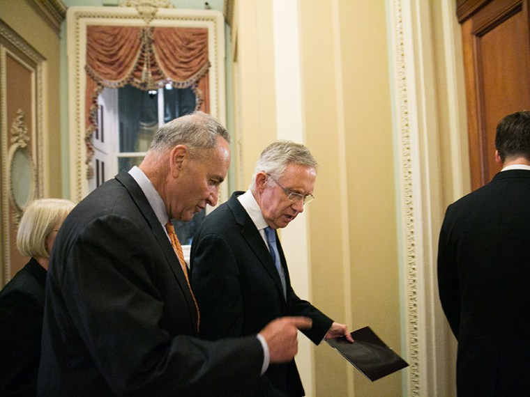 Sen. Chuck  Schumer (D-NY) and Senate Majority Leader Harry Reid (D-NV) walk to Reid's office after Senate joint caucus meeting, on July 15, 2013 in Washington, DC.  (Photo by Drew Angerer/Getty Images)