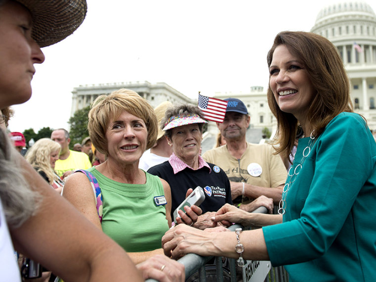 Minnesota Republican Representative Michele Bachmann greets demonstrators with the Tea Party during a protest against the Internal Revenue Service (IRS) targeting of the Tea Party and similar groups outside the US Capitol in Washington, DC, June 19,...