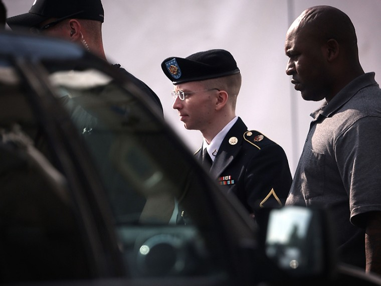 U.S. Army Private First Class Bradley Manning (C) is escorted as he leaves a military court for the day June 3, 2013 at Fort Meade in Maryland.  (Photo by Alex Wong/Getty Images)