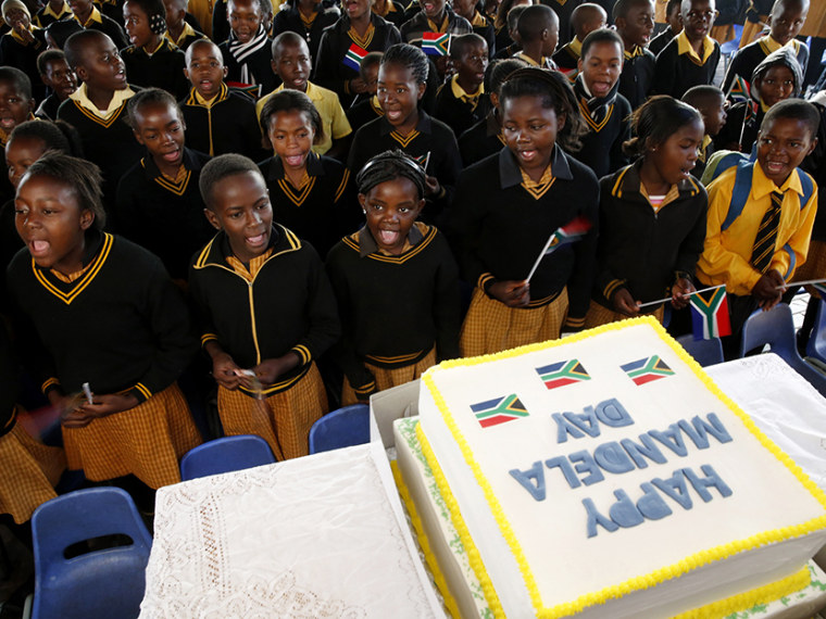 Children sing Happy Birthday to former President Nelson Mandela at a school in Atteridgevile near Pretoria, July 18, 2013. (Photo by Mike Hutchings/Reuters)