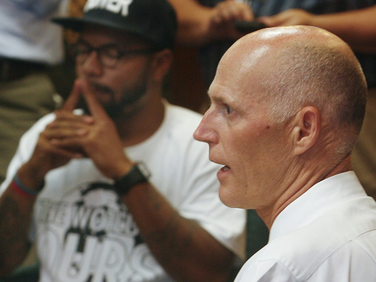 Florida Gov. Rick Scott speaks to protestors Thursday July 18, 2013 in the Capitol in Tallahassee, Fla. Florida Gov. Rick Scott is telling protesters that he will not ask lawmakers to revamp the state's self-defense laws. (Photo by Phil Sears/AP)