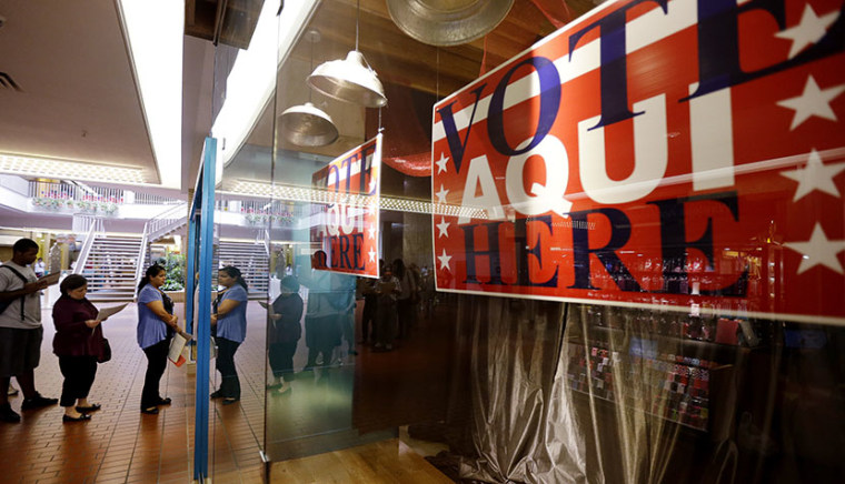 Voters wait in line at a polling place located inside a shopping mall on Election Day, Tuesday, Nov. 6, 2012, in Austin, Texas. (Photo by Eric Gay/AP)