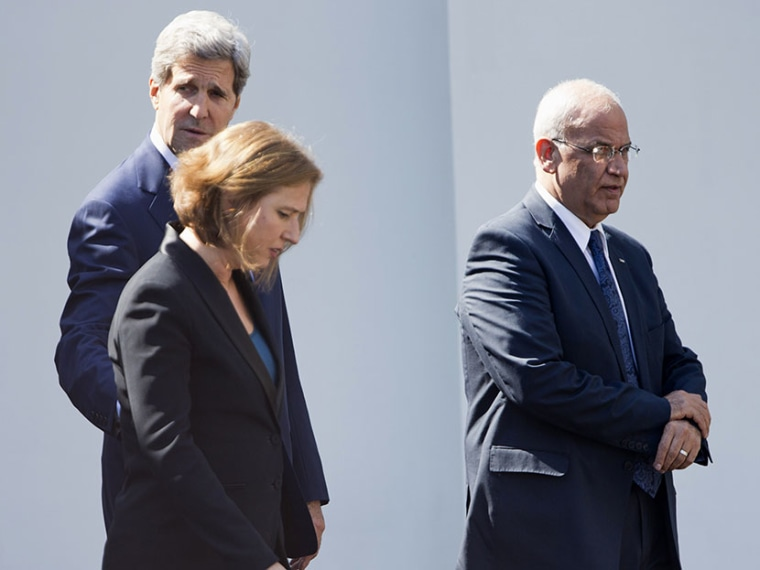 From left, Secretary of State John Kerry, Israeli Justice Minister Tzipi Livni and chief Palestinian negotiator Saeb Erakat leave the West Wing of the White House in Washington, Tuesday, July 30, 2013, after a meeting with President Obama. (Photo by...