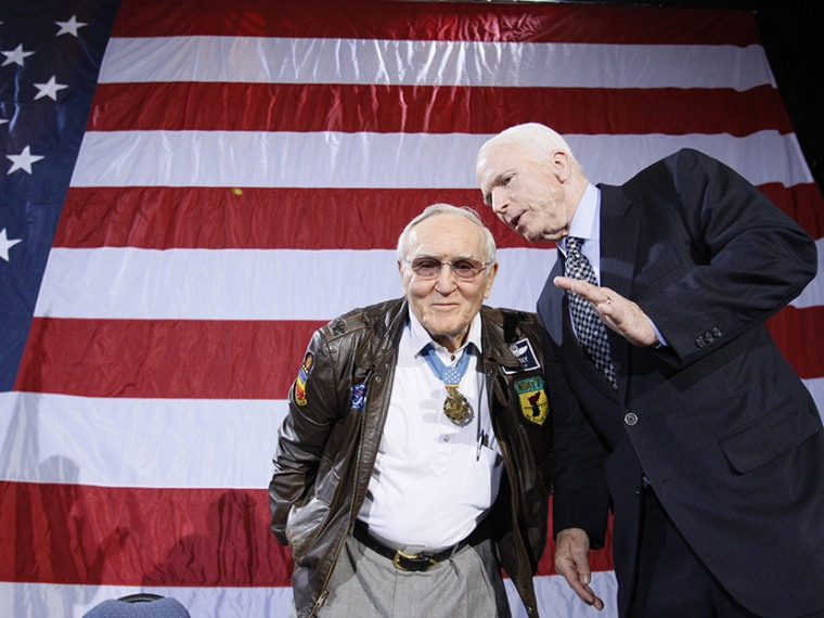 Retired U.S. Air Force Col. Bud Day, left, who was a prisoner of war in Vietnam with Senator John McCain, during a campaign rally at the Emerald Creek Conference Center in Ft. Walton Beach, Fla., Tuesday, Jan. 22, 2008. (Photo by Charles Dharapak/AP)
