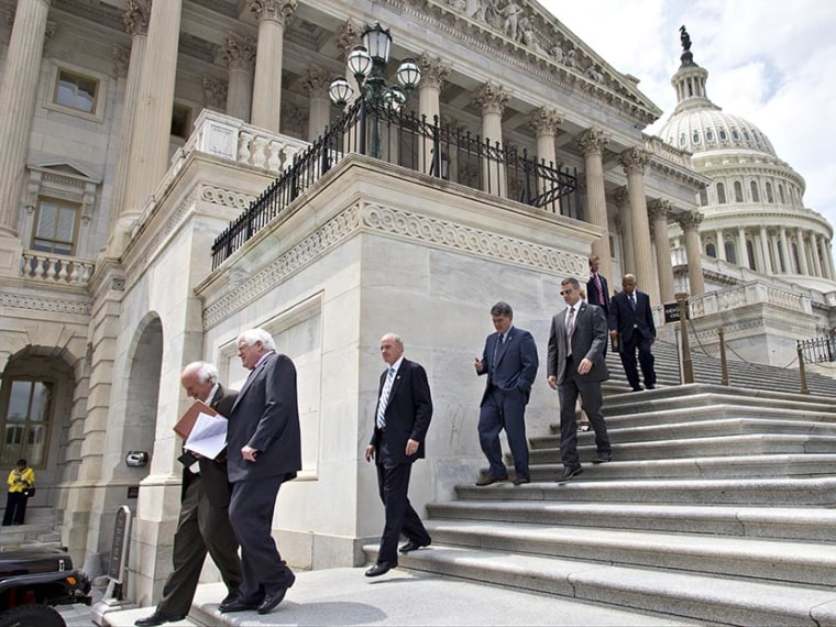Members of the House of Representatives walk down the steps of the Capitol after final votes in Washington, Wednesday, June 19, 2013.  (Photo by J. Scott Applewhite/AP)