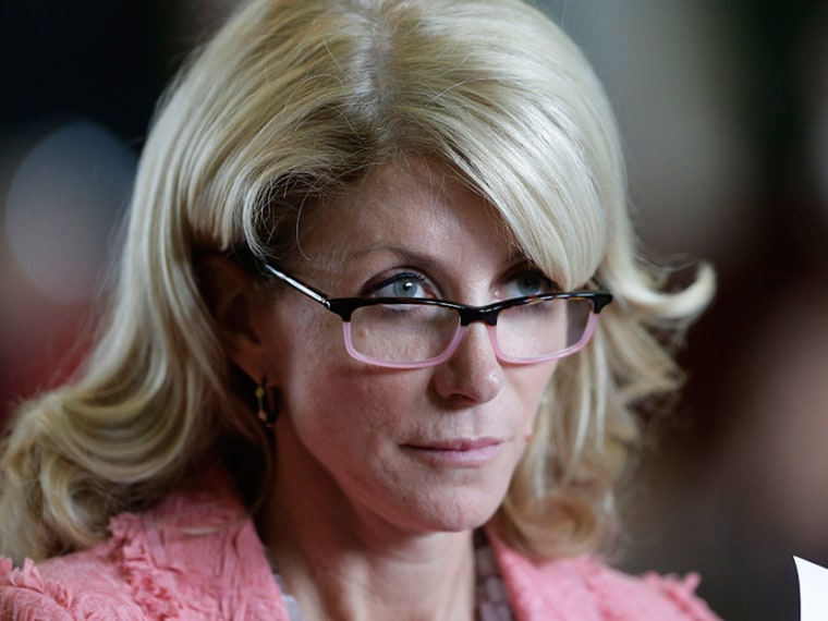 Sen. Wendy Davis, D-Fort Worth, listens as the Texas Senate debate an abortion bill before the final vote, Friday, July 12, 2013, in Austin, Texas. (Photo by Eric Gay/AP)
