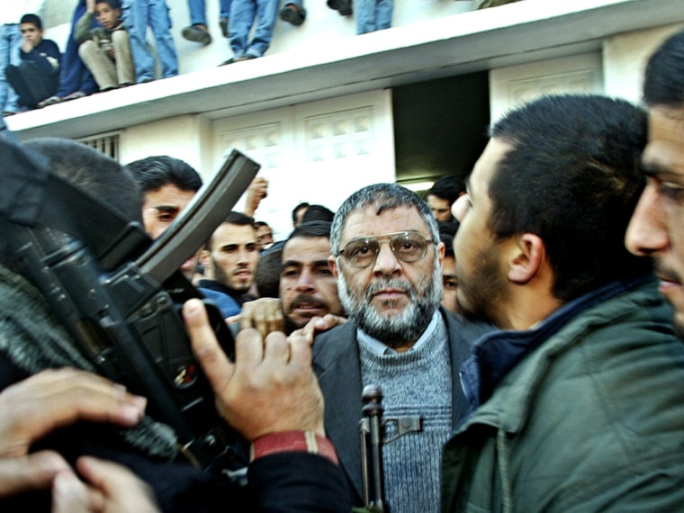 Abdel Aziz al-Rantissi, the top Hamas political leader, speaks to the press in front of the morgue containing the body of Sheikh Ahmed Yassin in Gaza city March 22, 2004. (Photo by Mohammed Salem/Reuters)