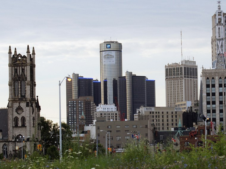 Downtown Detroit, including the General Motors World Headquarters (2nd L), is pictured from a vacant lot along Woodward Avenue in Detroit, Michigan July 21, 2013.    (Photo by Rebecca Cook/Reuters)