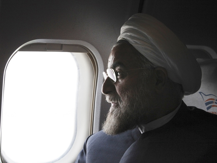 In this Monday, June 10, 2013, Iranian President, Hasan Rouhani, a former Iran's top nuclear negotiator, looks on, in his plane, during his presidential election campaign tour to the northwestern, Iran.  (Photo by Vahid Salemi/AP)