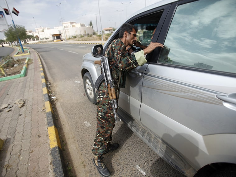 A police trooper inspects a car at a checkpoint near the British embassy in Sanaa August 3, 2013. (Photo by Khaled Abdullah/Reuters)