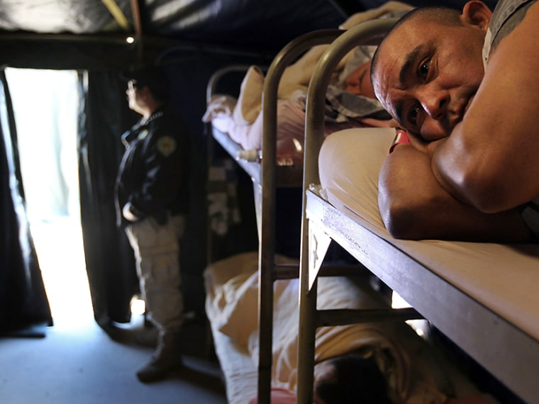 """Undocumented Mexican immigrant Gabriel Lopez, 34, lies on his bunk bed at the Maricopa County """"Tent City Jail"""" on April 30, 2010 in Phoenix, Arizona.  (Photo by John Moore/Getty Images)"""