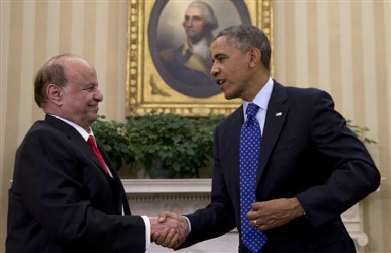 President Barack Obama and Yemen's president Abdo Rabby Mansour Hadi shake hands, Aug. 1, 2013. (AP Photo/Carolyn Kaster)