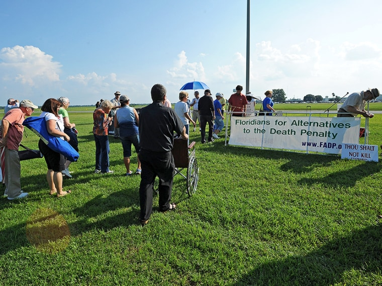 Protesters to the death penalty gather across the highway from the Florida State Correctional facility near Starke, Florida, Monday, Aug. 5, 2013.  (Photo by Phil Sandlin/AP)