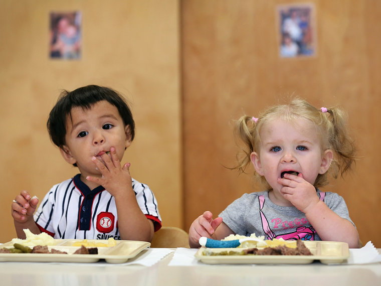 Children eat lunch at the federally-funded Head Start school on September 20, 2012 in Woodbourne, New York. (Photo by John Moore/Getty)