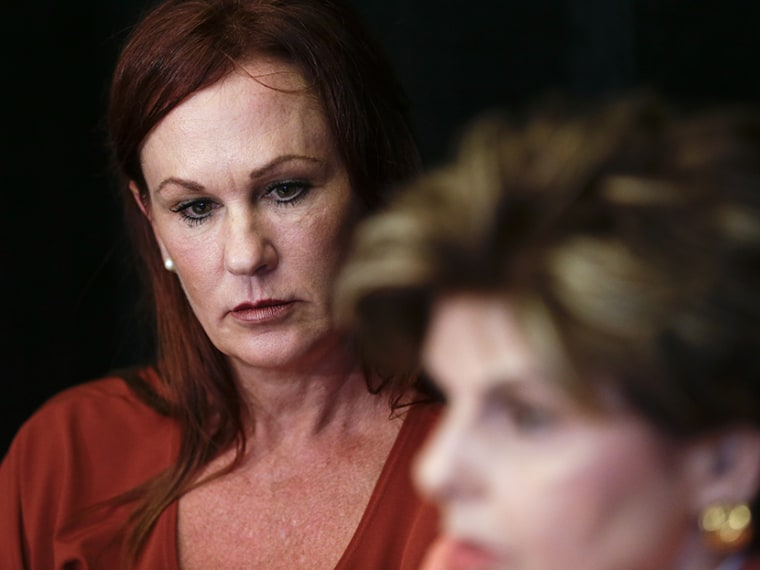 Michelle Tyler looks on as attorney Gloria Allred speaks during a news conference Tuesday, Aug. 6, 2013, in San Diego. Tyler, a nurse, said Tuesday she was the victim of allegedly inappropriate sexual behavior by San Diego Mayor Bob Filner during a...