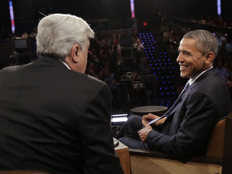 Jay Leno talks with President Barack Obama during a commerical break on August 6, 2013 (Photo by Paul Drinkwater/NBC/Getty Images)