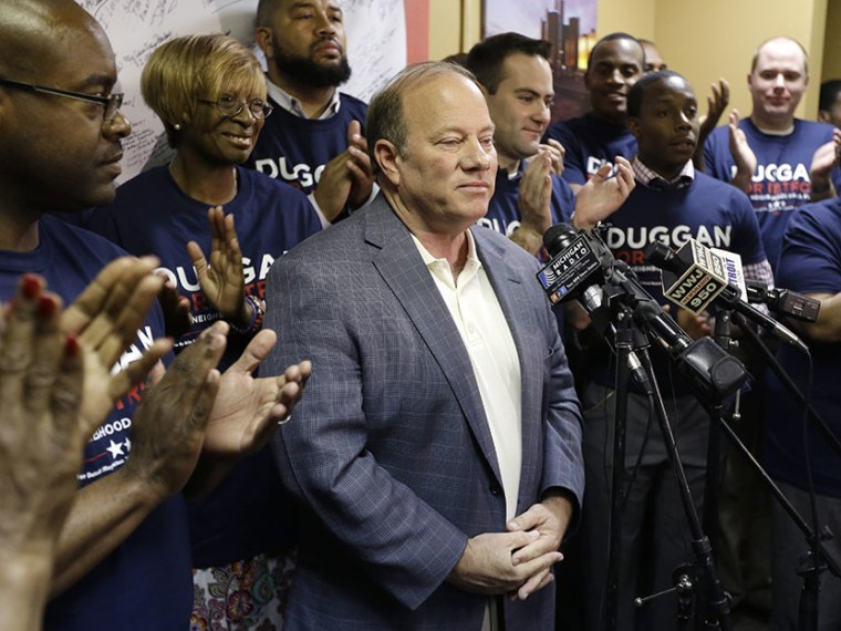 Supporters applaud Detroit mayoral candidate Mike Duggan after he addressed the media at his campaign headquarters in Detroit, Wednesday, June 12, 2013. (Photo by Carlos Osorio/AP)
