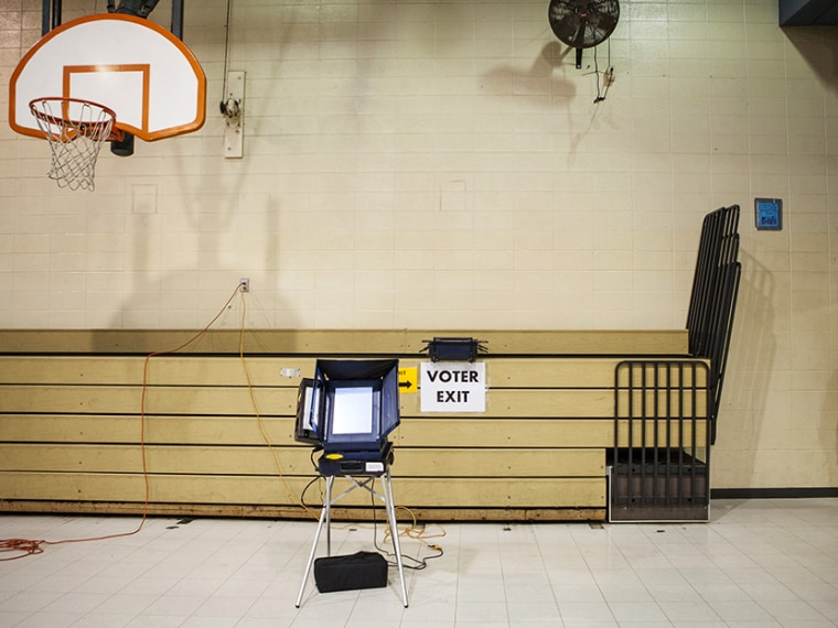 A voting booth awaits voters at the Dr. Martin Luther King Community Center on the morning of U.S. presidential election in Racine, Wisconsin November 6, 2012. (Photo by Sara Stathas/Reuters)