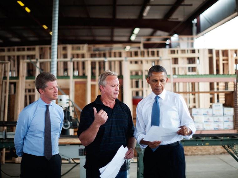 US President Barack Obama and Housing Secretary Shaun Donovan tour Erickson Construction on August 6, 2013 in Chandler, Arizona. (Photo by Mandel Ngan/AFP/Getty)