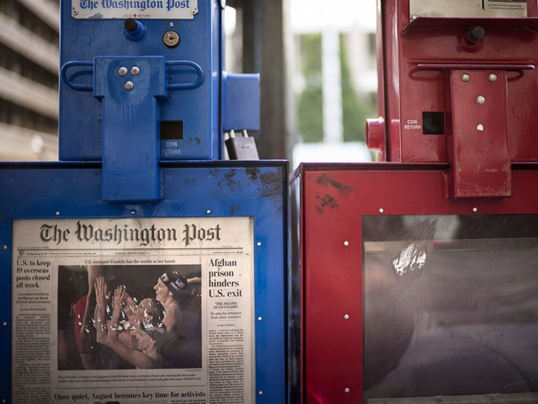 A Washington Post newspaper box (L) stands beside the empty box of competitor Washington Times (R) outside the Washington Post on August 5, 2013 in Washington, DC, after it was announced that Amazon.com founder and CEO Jeff Bezos had agreed to purchase...