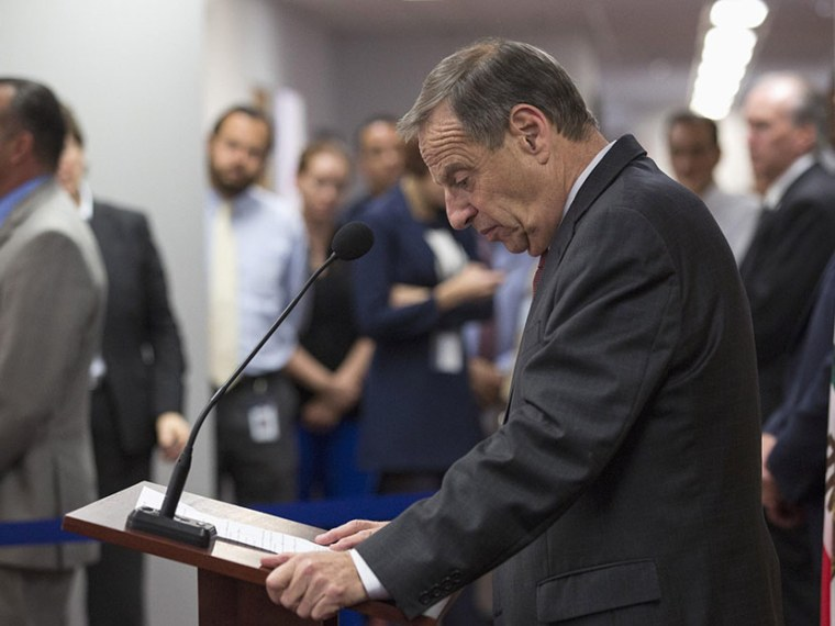 San Diego mayor Bob Filner looks down at the podium while speaking at a news conference in San Diego, California July 26, 2013. (Photo by Fred Greaves/Reuters)