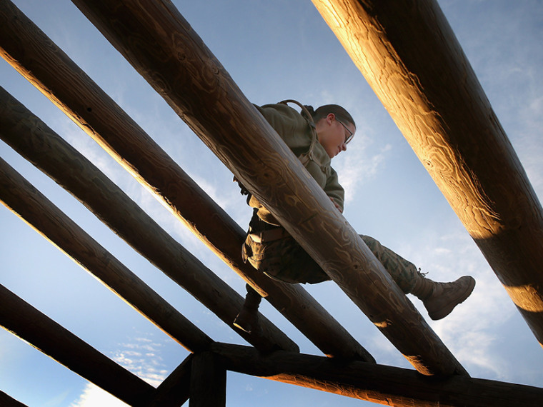 A female Marine runs through an obstacle on the Confidence Course during Marine Combat Training (MCT) on February 20, 2013 at Camp Lejeune, North Carolina.  (Photo by Scott Olson/Getty Images)