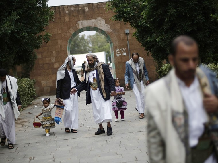 Yemenis gather after Eid al-Fitr prayers that marks the end of the holy fasting month of Ramadan on the first day of Eid al-Fitr in Sanaa, Yemen, Thursday, Aug. 8, 2013. (Photo by Hani Mohammed/AP)