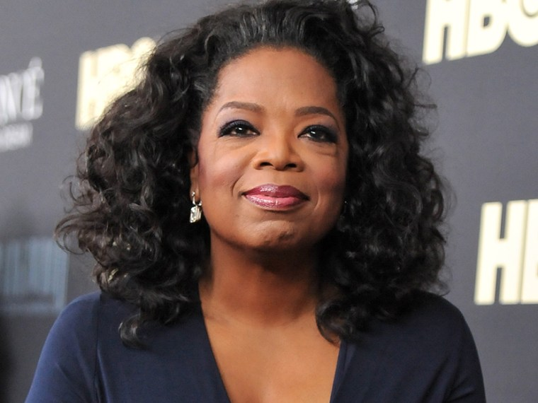 """Media mogul Oprah Winfrey attends the premiere of """"Beyonce: Life Is But A Dream"""" at the Ziegfeld Theatre on Tuesday, Feb. 12, 2013 in New York. (Photo by Evan Agostini/Invision/AP)"""