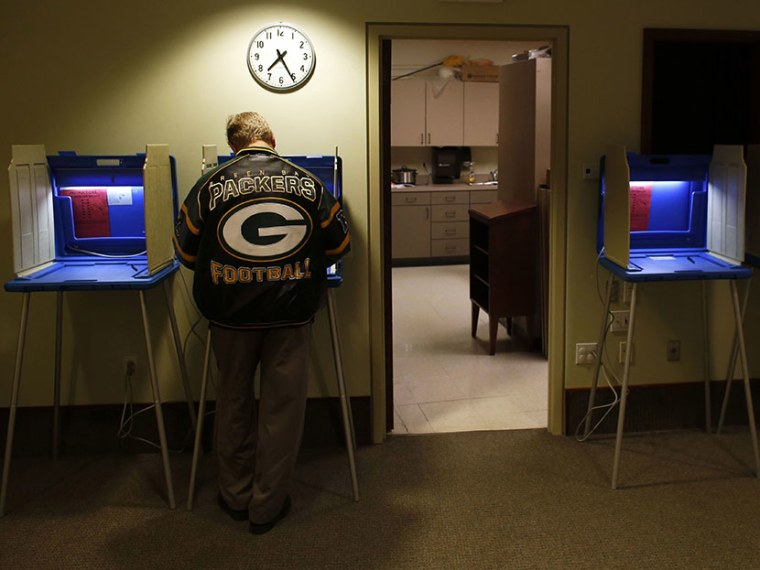 Voters cast their vote in the Presidential elections on November, 6, 2012 in Janesville Wisconsin. (Photo by Darren Hauck/Getty)