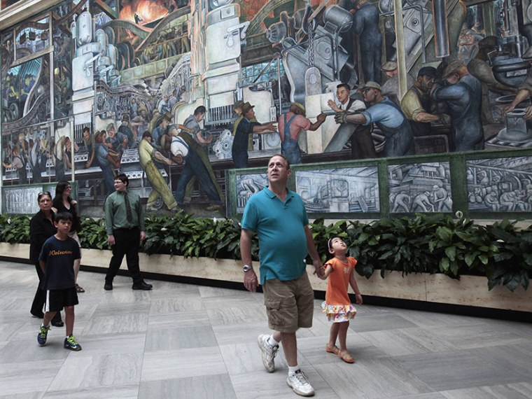 Visitors at the Detroit Institute of Arts museum look at the work by famed muralist Diego Rivera in Detroit, Michigan June 2, 2013. (Photo by Rebecca Cook/Reuters)