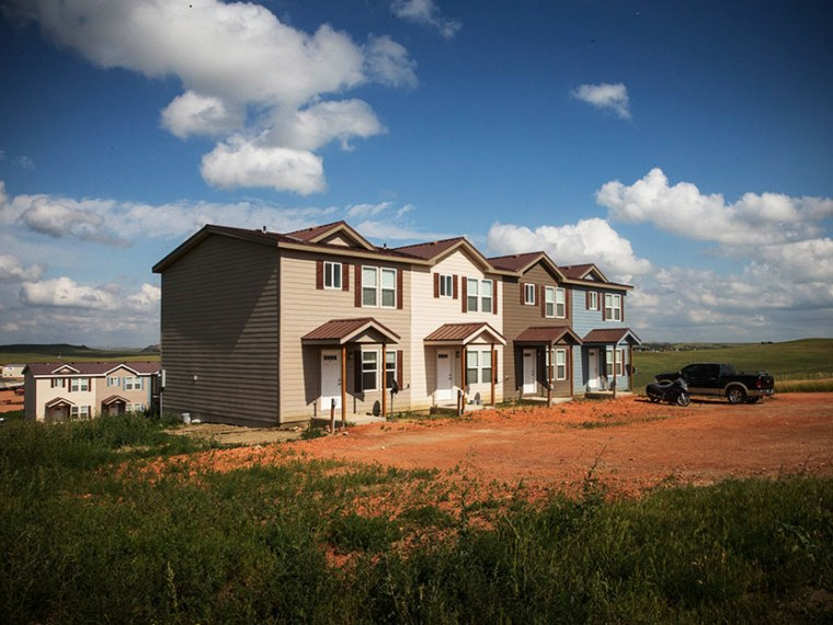 New townhouses are seen next to a highway on July 29, 2013 in Watford City, North Dakota. (Photo by Andrew Burton/Getty)