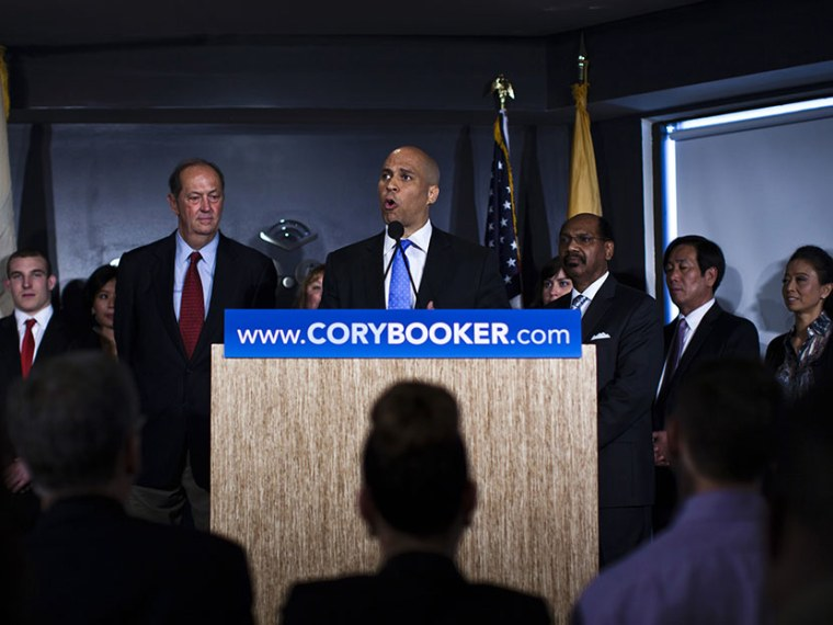 Newark Mayor Cory Booker talks to the media next to former Senator Bill Bradley as he announces his plans to run for the U.S. Senate seat during a news conference in Newark, June 8, 2013. (Photo by Eduardo Munoz/Reuters)