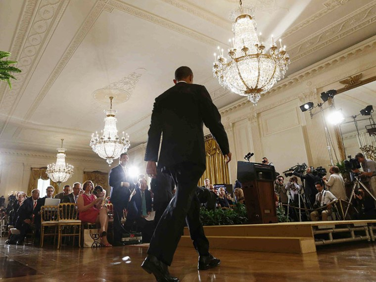 President Barack Obama arrives for his news conference in the East Room at the White House in Washington, Friday, Aug. 9, 2013. (Photo by Charles Dharapak/AP)