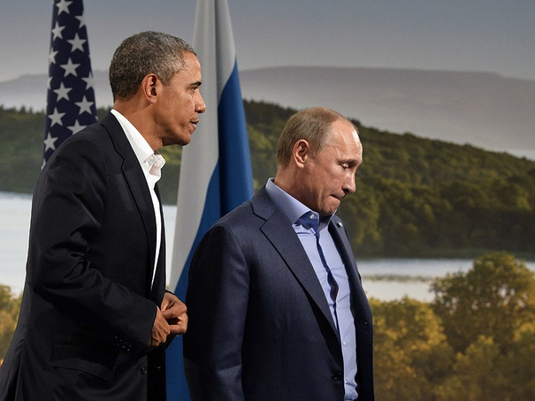 US President Barack Obama (L) holds a bilateral meeting with Russian President Vladimir Putin during the G8 summit at the Lough Erne resort near Enniskillen in Northern Ireland, on June 17, 2013. (Photo by Jewel Samad/AFP/Getty Images)