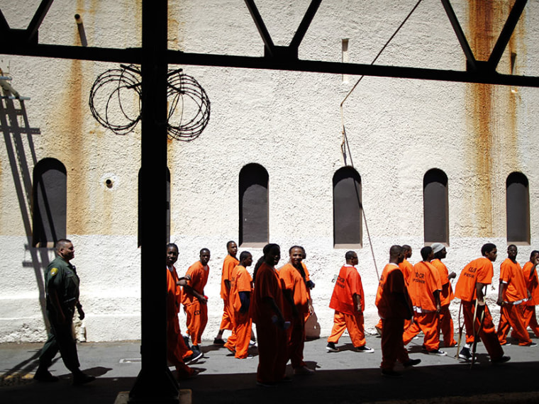 Inmates walk in San Quentin state prison in San Quentin, California June 8, 2012.  (Photo by Lucy Nicholson/Reuters)