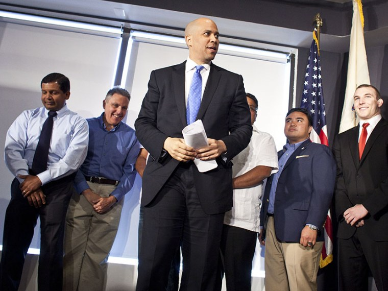 Newark Mayor Cory Booker steps on a stage during a news conference to discuss his plans to campaign for the Democratic nomination to run for the seat of late U.S. Sen. Frank Lautenberg on June 8, 2013 in Newark, New Jersey. (Photo by Ramin Talaie/Getty)