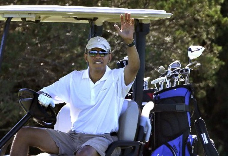 President Barack Obama waves to a group of on-lookers while golfing at Farm Neck Golf Club in Oak Bluffs, Mass., on the island of Martha's Vineyard, Sunday, Aug. 11, 2013. (AP Photo/Steven Senne)