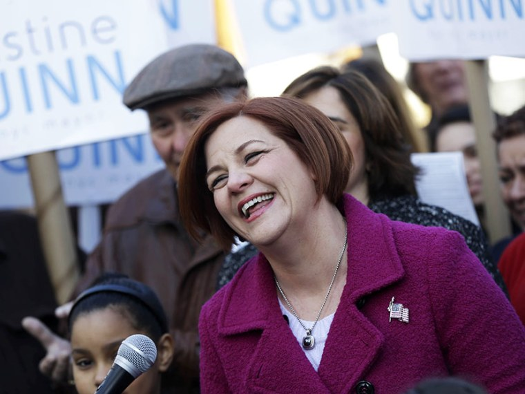 Surrounded by family and supporters, New York City Council speaker and mayoral hopeful Christine Quinn, center, laughs while speaking to the media as she announces her mayoral run in New York, Sunday, March 10, 2013. (Photo by Seth Wenig/AP)