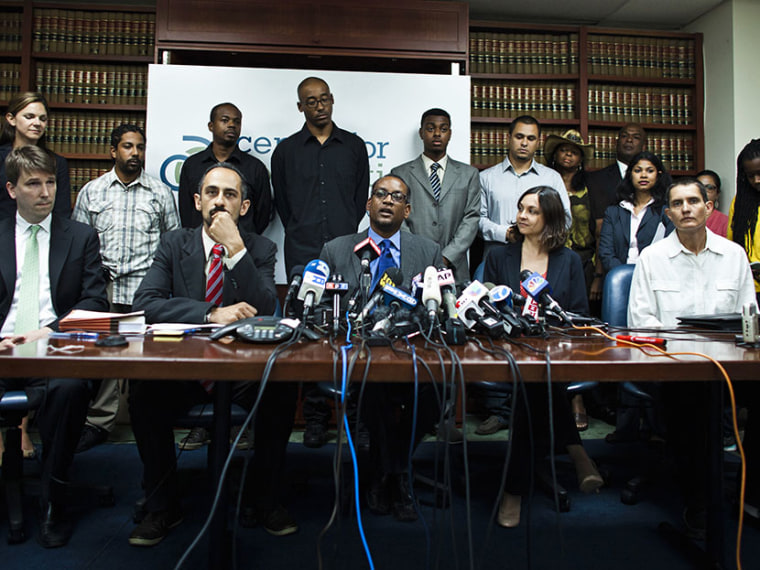 """Vince Warren, Executive Director of the Center for Constitutional Rights, speaks to the media about the \""""stop and frisk\"""" court decision during a news conference in New York, August 12, 2013. (Photo by Eduardo Munoz/Reuters)"""