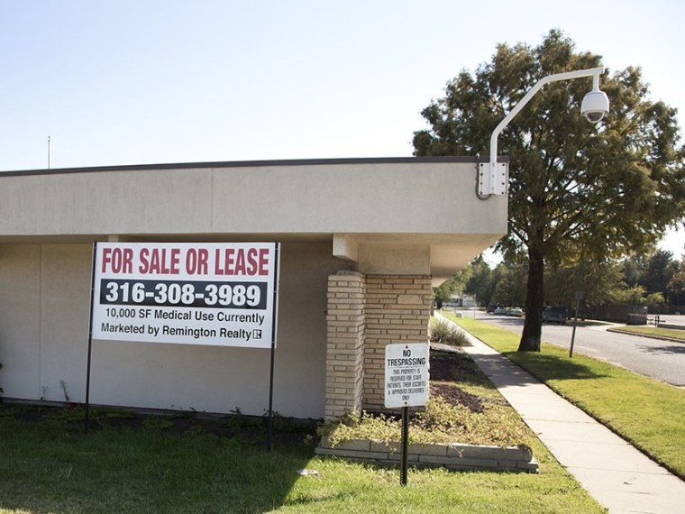 """A \""""for sale\"""" sign is posted outside the Kansas medical clinic formerly operated by murdered abortion provider Dr. George Tiller, Thursday, Oct. 7, 2010, in Wichita, Kan. (Photo by Jeff Tuttle/AP)"""