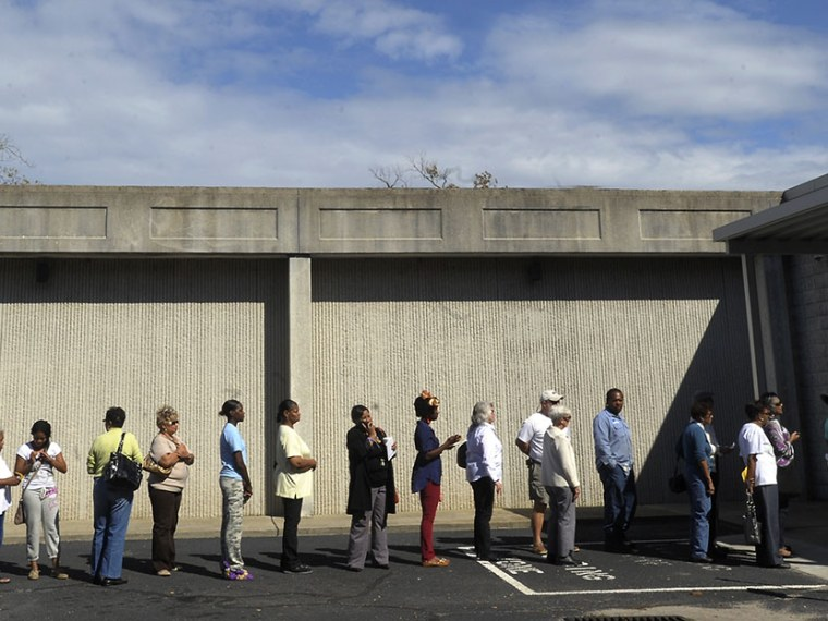 People wait in line to vote at the Board of Elections early voting site on October 18, 2012 in Wilson, North Carolina. (Photo by Sara D. Davis/Getty Images)