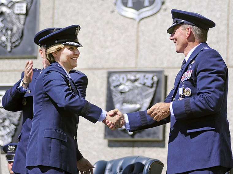Newly-named superintendent of the United States Air Force Academy Lt. Gen. Michelle Johnson shakes hands with Lt. Gen. Mike Gould after being recognized during a change of command ceremony at the Academy in Colorado, August 12, 2013 (Photo by Sarah...