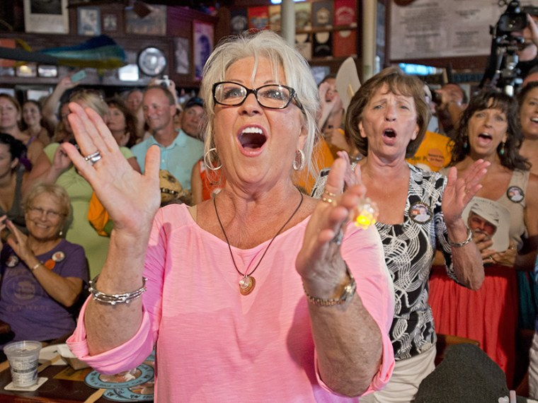 Paula Deen cheers for her husband Michael Groover during the semi-finals of the 'Papa' Hemingway Look-Alike Contest in Key West, Florida, July 21, 2012. (Photo by Andy Newman/Florida Keys News/EPA)