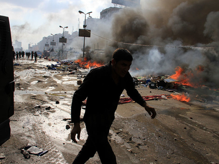 Egyptian security forces clear a sit-in by supporters of ousted Islamist President Mohammed Morsi in the eastern Nasr City district of Cairo, Egypt, Wednesday, Aug. 14, 2013. (Photo by Ahmed Gomaa/AP)