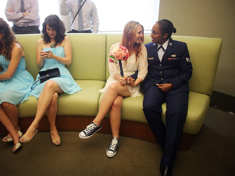 U.S. Air Force Senior Airman Shyla Smith (R) and Courtney Burdeshaw (2nd R) wait to get married along with guests waiting for another wedding at the Manhattan Marriage Bureau the day after the U.S. Supreme Court ruling on DOMA on June 27, 2013 in New...