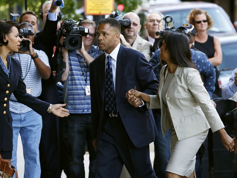 Jesse Jackson Jr. (C) and his wife Sandi (front) arrive in court for their sentencing hearing in Washington, August 14, 2013. (Photo by Kevin Lamarque/Reuters)