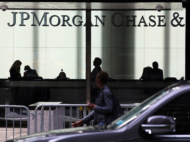 People pass a sign for JPMorgan Chase & Co. at it's headquarters in Manhattan on October 2, 2012 in New York City.  (Photo by Spencer Platt/Getty Images)
