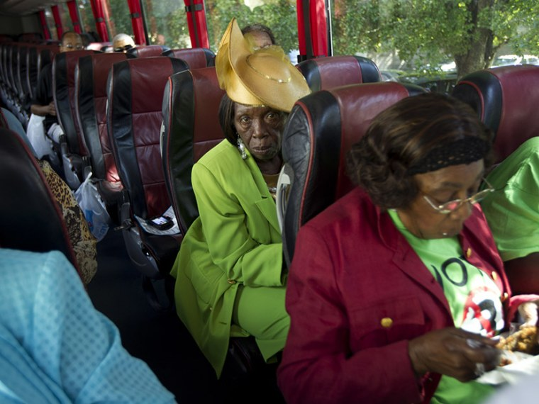 """Martha Frazier rides a bus to a \""""Souls to the Polls\"""" rally in Miami, Sunday, Oct. 28, 2012.  (Photo by J. Pat Carter/AP)"""