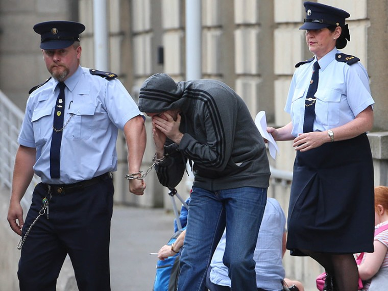 Eric Eoin Marques is led away from the High Court in Dublin after authorities in the United States have formally requested his extradition. Picture date: Thursday August 15, 2013. (Photo by Niall Carson/PA Wire/AP)